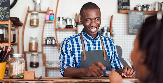 image of a smiling barista